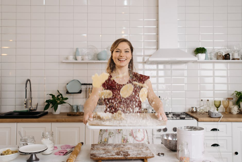A woman on a kitchen counter